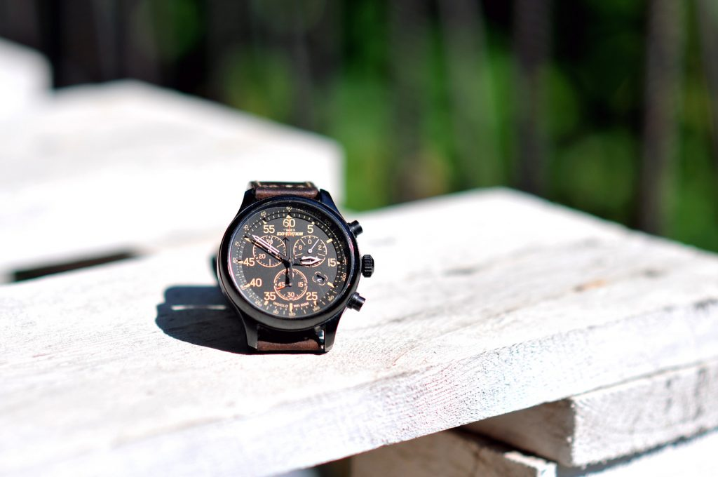 Timex brown watch on a wooden surface