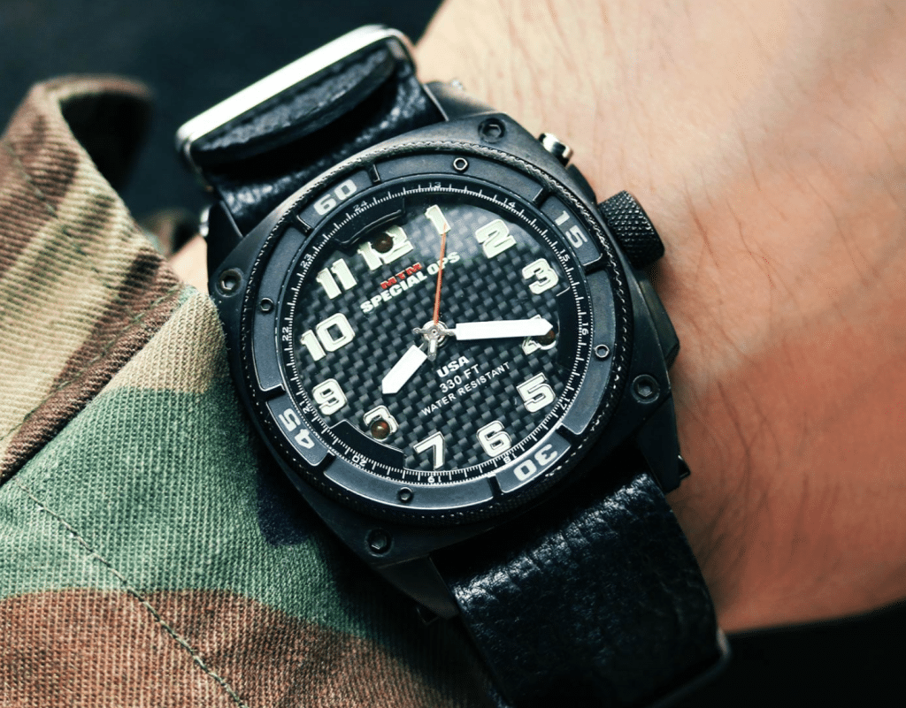black MTM military watch on a soldier's hand
