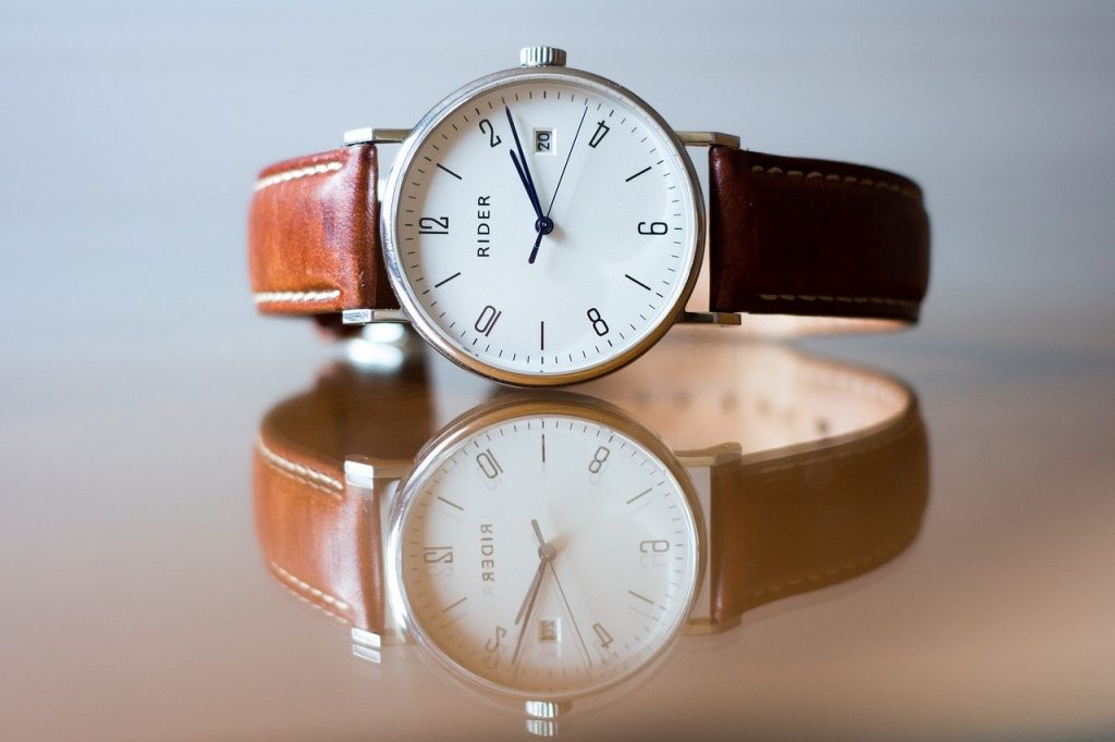 classic analog watch with white dial and brown straps