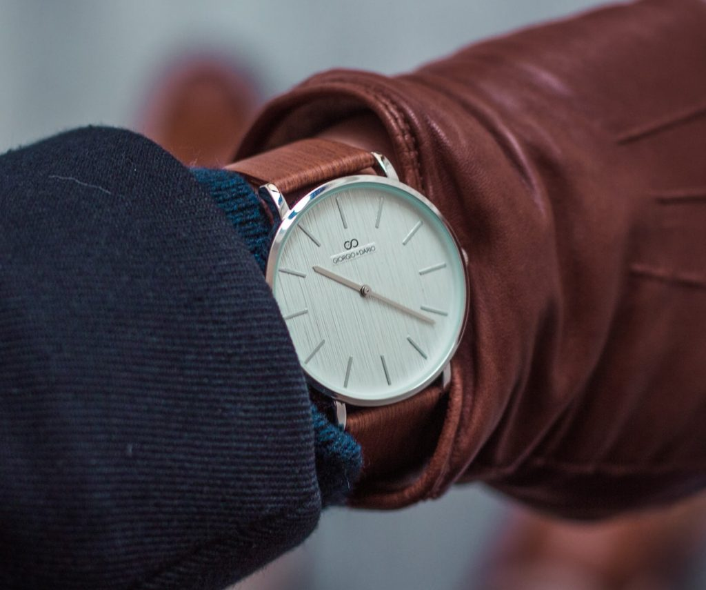 minimalist dress watch with white dial and brown leather strap