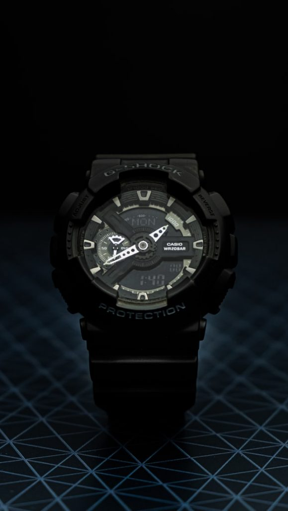 black g-shock military watch with dark dial