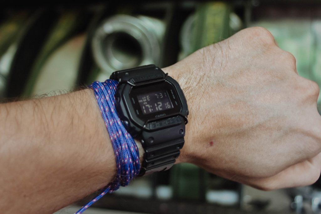 g-shock tactical watch with digital display on a man's wrist