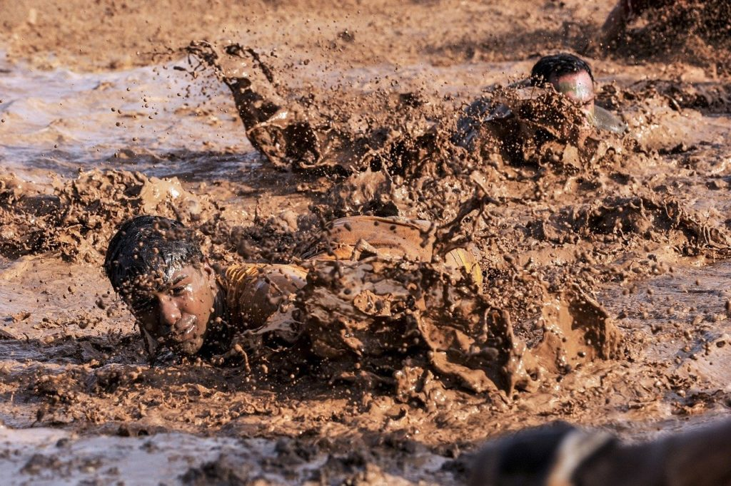soldiers crawling in mud