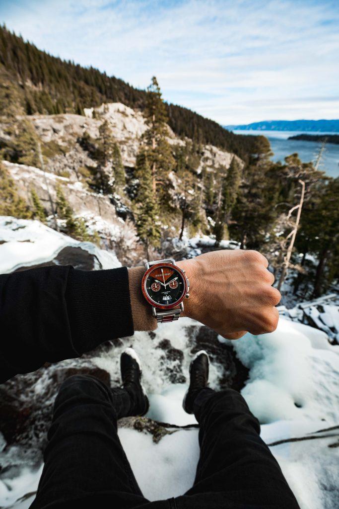 Original Grain wooden timepiece on a hiker's wrist