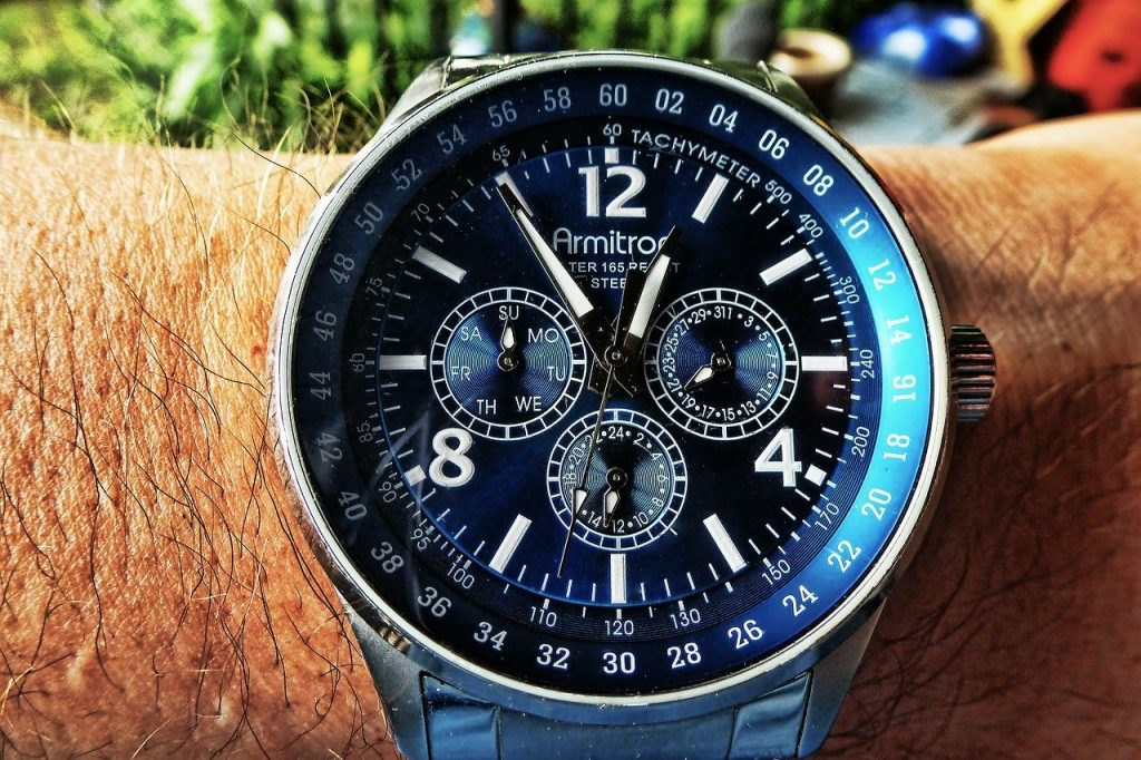 racing watch with a chronograph and tachymeter