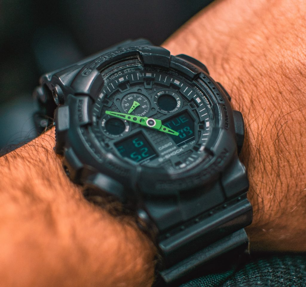 Black G-shock military watch with green hands