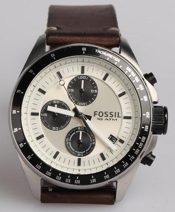 white-faced watch with dark sub-dials