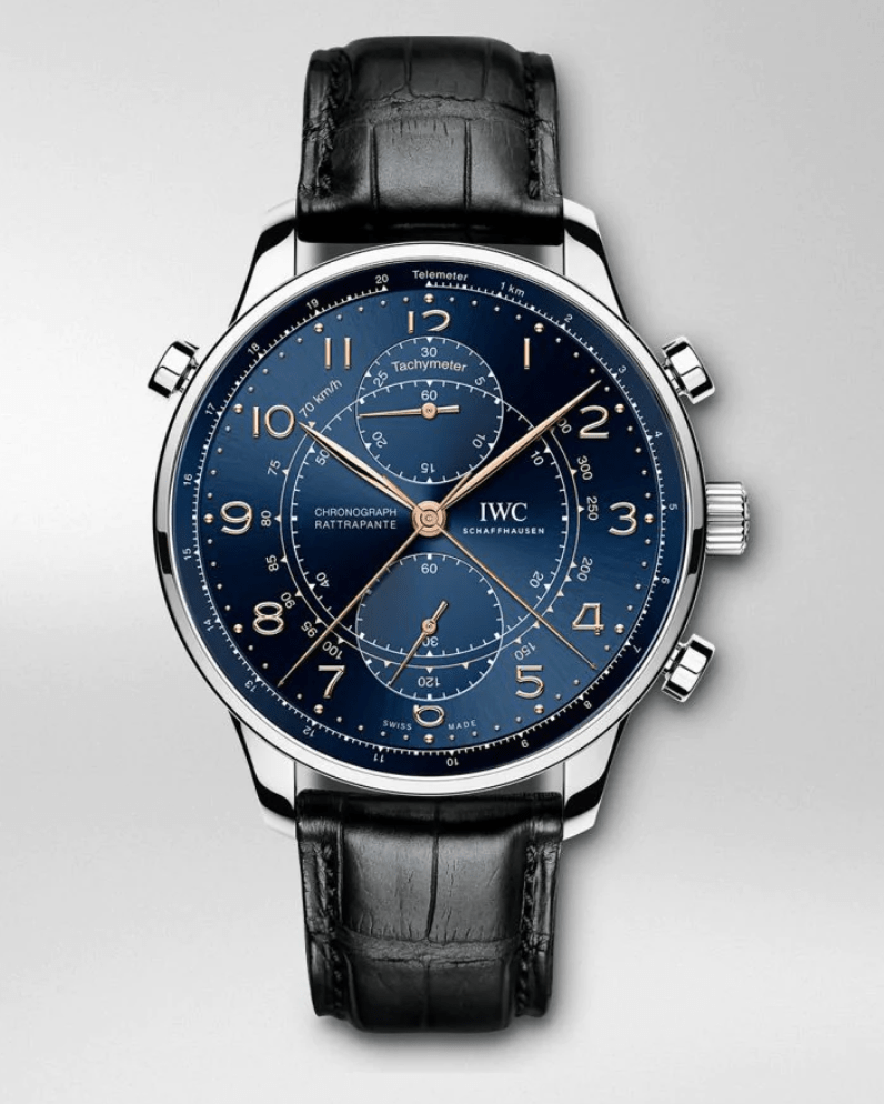 luxury watch with deep blue dial and 3 pushers