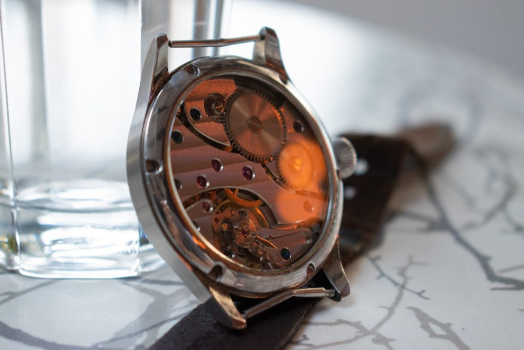 automatic movement watch with intricate build-up visible