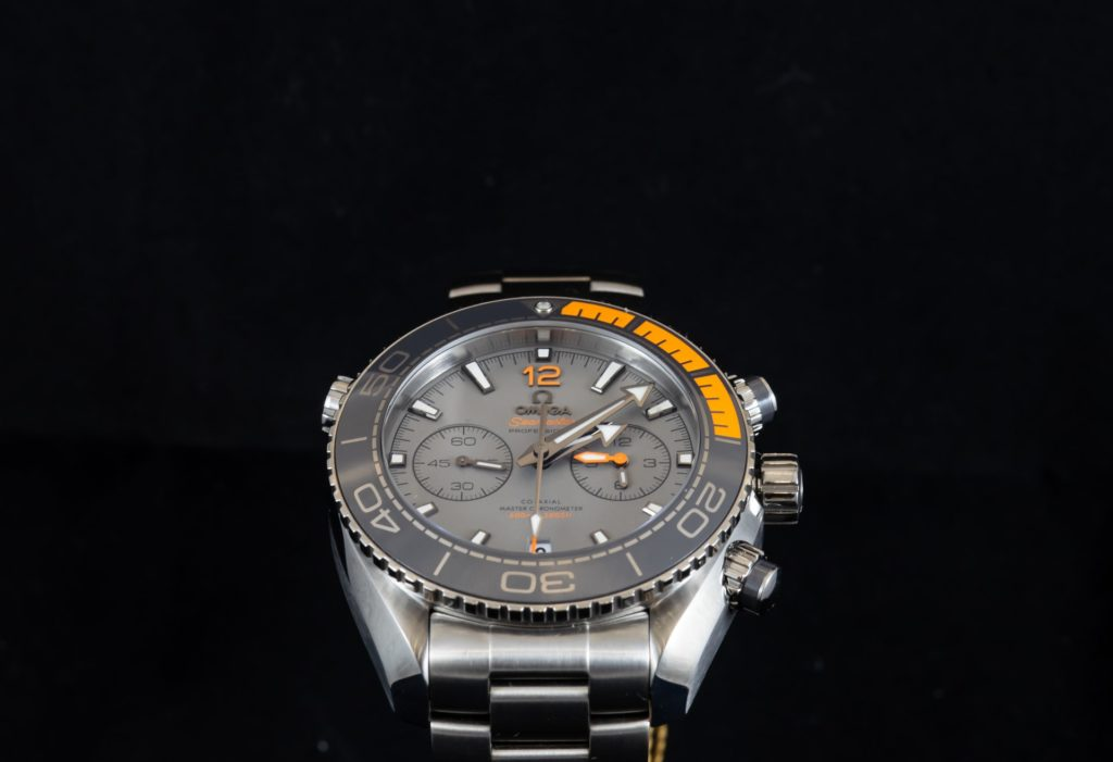 gray-dial dive wristwatch with orange parts