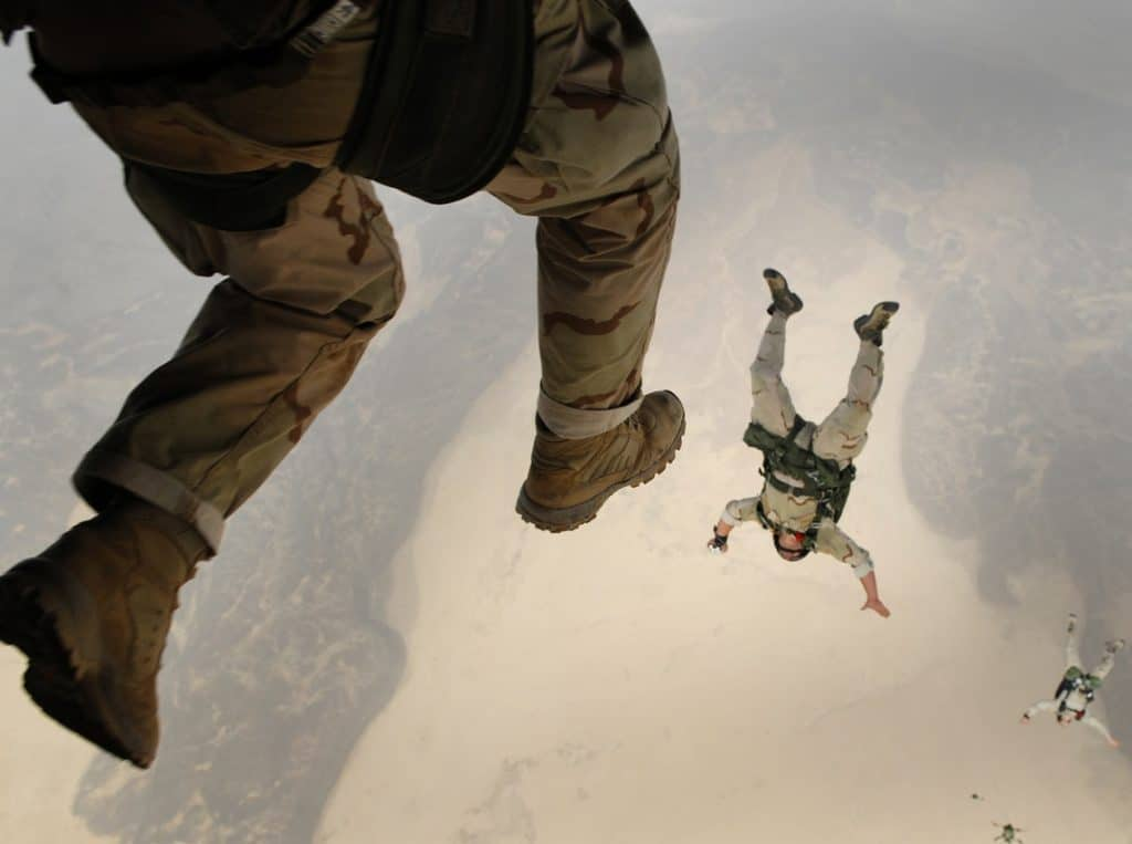 soldiers jumping out of a plane