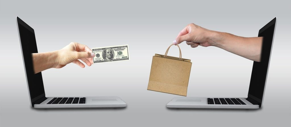 people exchanging money and goods online