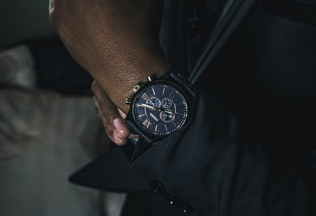 fashionably designed Fossil wristwatch on a man's wrist