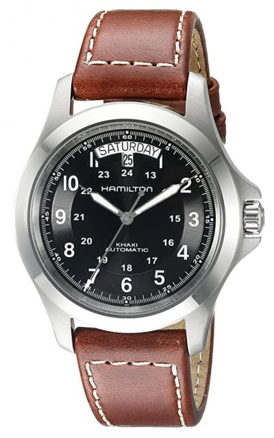black and brown field watch with gliding hand