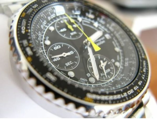 Watch with busy dial and slide rule bezel