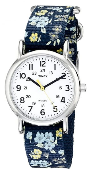 White-faced timepiece with fabric strap