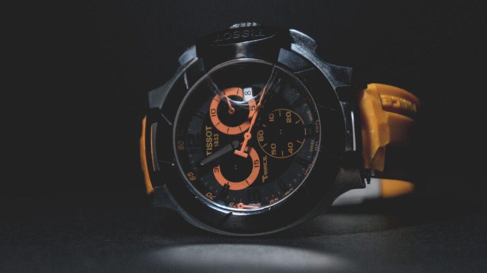 Tissot watch with orange present