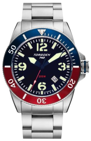 A dive-inspired watch with red and blue bezel and metal band